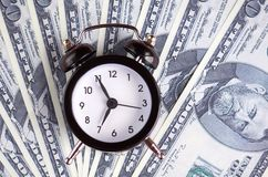 US dollars with clock composition, flat lay. And top view photo money business finance currency concept background financial cash investment bank economy wealth royalty free stock images