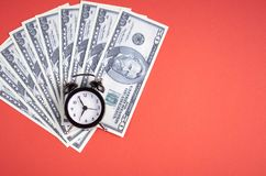 US dollars with clock on red background composition. Flat lay and top view photo money business finance currency concept financial cash investment bank economy stock photos