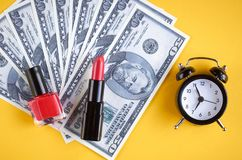 US dollars with clock on yellow background composition. Flat lay and top view photo money business finance currency concept financial cash investment bank royalty free stock photography