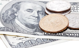 Us dollars and coins Stock Images