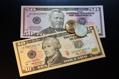 Us dollars coins and banknotes Stock Image