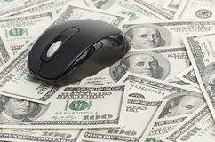 US Dollars and Computer Mouse Royalty Free Stock Image