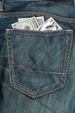 US dollars and condom in the jeans pocket Royalty Free Stock Photos