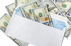 Dollars in a white envelope on white royalty free stock images
