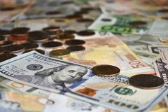 Us dollars  euros and coins royalty free stock photography