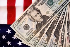US Dollars and flag. US 20 dollar notes and US flag Stock Photo