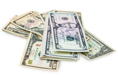US dollars isolated. A lot of cash US dollars assorted bills, cash pile on white background.with clipping path Stock Photos