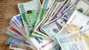 US dollars, Korean Won, Euro bills and some money bills and banknotes. Currency foreign exchange. Business and Financial or money management for investments Stock Images
