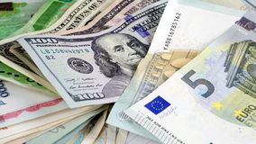 US dollars, Korean Won, Euro bills and some money bills and banknotes. Currency foreign exchange. Business and Financial or money management for investments Stock Photos