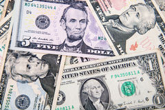 US dollars. A lot of cash US dollars assorted bills, cash pile background Stock Images