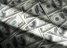 US dollars. Many lying 100 US dollars banknotes stock photos