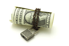 US dollars notes chained and locked Royalty Free Stock Photos