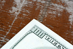 US dollars on old wooden plank Stock Photo