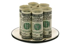 US Dollars On A Glass Saucer Stock Photos