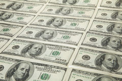 Us dollars in raw. On white background Stock Image