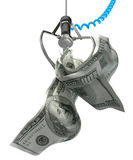 US Dollars In A Robotic Claw Royalty Free Stock Photography