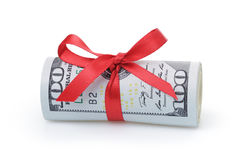 Us dollars rolled and tied with red ribbon Stock Photography