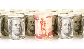 US dollars and Russian roubles banknotes Stock Images