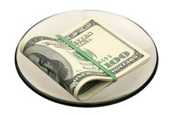 US dollars on a saucer Stock Image