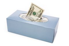 Us dollars in a tissue box Royalty Free Stock Image