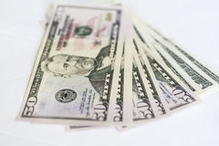 US dollars on a white background. Money Stock Photos
