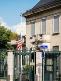 US Embassy flag half-mast after attacks killing in Las Vegas. PARIS, FRANCE - OCT 3, 2017: US United States American Flag flying half-mast in court of the US Stock Photo