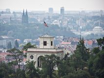 US embassy, Prague, Czechia. USA, embassy Prague, Czechia. View from Prague Castle. Starspangled banner on roof Royalty Free Stock Image