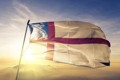 US Episcopal Church flag textile cloth fabric waving on the top sunrise mist fog royalty free stock images