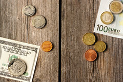 US and euro money over wooden background Stock Photography
