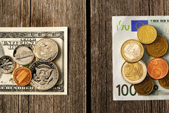US and euro money over wooden background Royalty Free Stock Images