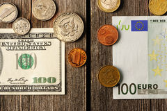 US and euro money over wooden background Royalty Free Stock Image
