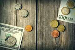 US and euro money over wooden background stock photos