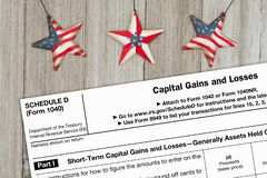 A US Federal tax 1040 schedule D income tax form