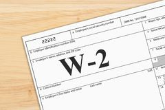 A US Federal tax W2 income tax form. On a desk royalty free stock photos