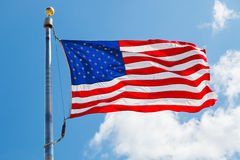 US Flag. Over blue sky Royalty Free Stock Image