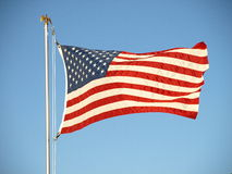 US Flag. United States Flag on flagpole, blowing in the breeze Stock Images
