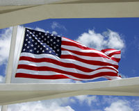 US Flag above USS Arizona Memorial. Pearl Harbor, Oahu, Hawaii Royalty Free Stock Image