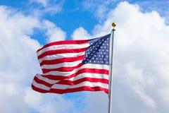 US Flag. Against blue sky stock image