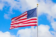 US Flag. Against blue sky royalty free stock photography