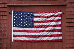 US flag on barn door. US Flag displayed on red barn door on Memorial Day, 2011, outside of Lexington, MA Royalty Free Stock Images