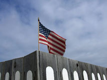 US Flag behind Fence Stock Photography