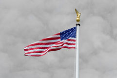 US Flag with black and white sky. US Stars and stripes flag in colour with background sky and clouds in black and white Royalty Free Stock Images