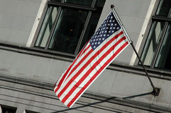US Flag on a building. US flag on a gray building stock photography