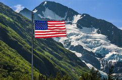 US Flag at Byron Glacier. US Flag stands straight out in front of Byron Glacier Stock Image