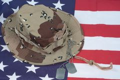 US Flag with Camouflage Combat Hat and Dog Tags Royalty Free Stock Photo