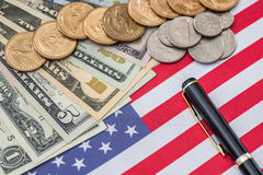 Us flag and cent coins, nationalism concept. Abstract business background - us flag and cent coins, nationalism concept stock images