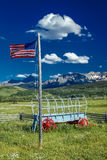 US Flag and covered wagon, Hastings Mesa, near Ridgway, Colorado. Royalty Free Stock Photos