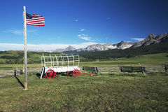 US Flag and covered wagon, Hastings Mesa, near Ridgway, Colorado, USA Stock Images