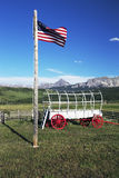 US Flag and covered wagon, Hastings Mesa, near Ridgway, Colorado, USA Royalty Free Stock Images