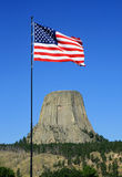 US flag at devils tower Royalty Free Stock Photos